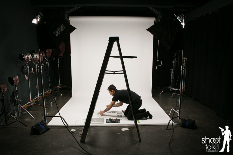Devin meticulously prepping some of his work to be photographed.